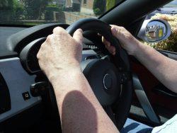 Graham White driving his car