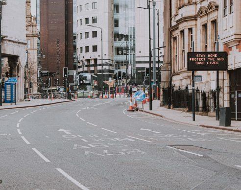people crossing on pedestrian lane during daytime